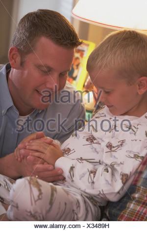 Children Praying By Bedside Stock Photo 14262516 Alamy