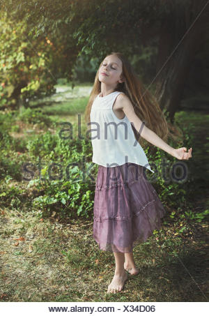 Girl dancing in the forest - Stock Photo