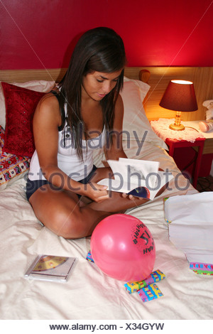 young woman celebrating her 21st birthday - Stock Photo