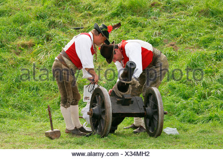 Gun salute being fired from a cannon at a folk festival in Muehldorf am Inn, Upper Bavaria, Bavaria, Germany, Europe - Stock Photo