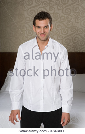 Young man wearing white shirt - Stock Photo