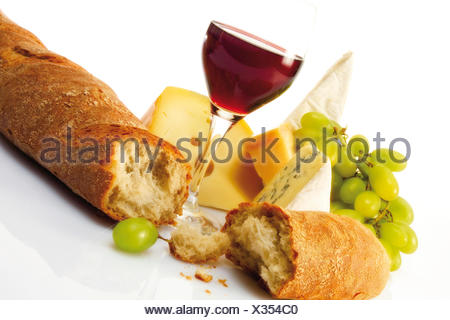 Baguette with a glass of red wine and various types of cheese - Stock Photo