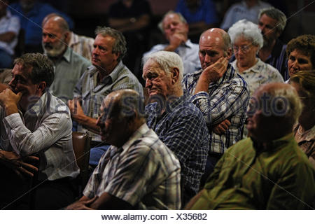 Rice farmers discuss water issues at a meeting. - Stock Photo