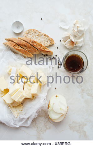 Sliced bread, butter and garlic - Stock Photo