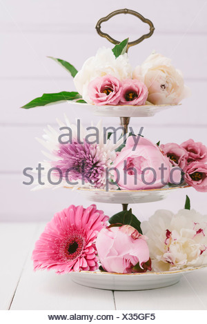 Summer flowers arranged on cake stand - Stock Photo