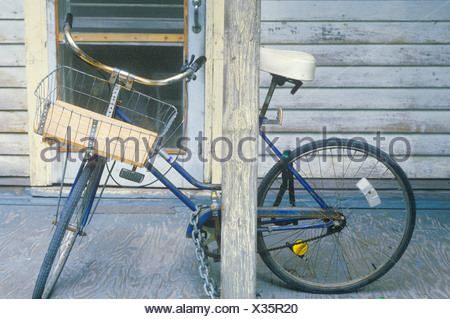 Bicycle parked on front porch, Key West, FL - Stock Photo