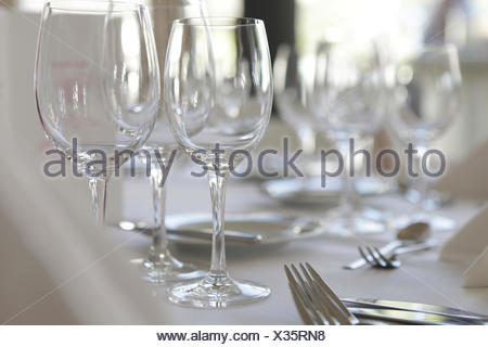 Glasses standing on a laid table - Stock Photo