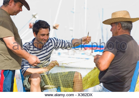 Fisher preparing their net - Stock Photo