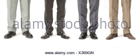 Four businessmen standing in a row, detail of legs - Stock Photo