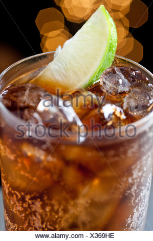 Cola drink with lime - Stock Photo
