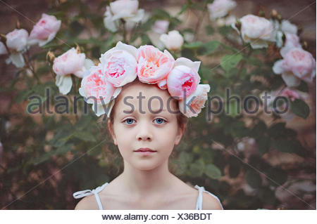 Girl wearing a headdress with roses - Stock Photo