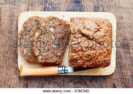 Zucchini Bread including zucchini, banana and walnuts as ingredients - Stock Photo
