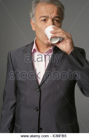 Businessman drinking a cup of water - Stock Photo