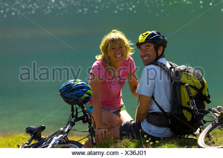 couple taking a break during a bicycle tour, France - Stock Photo