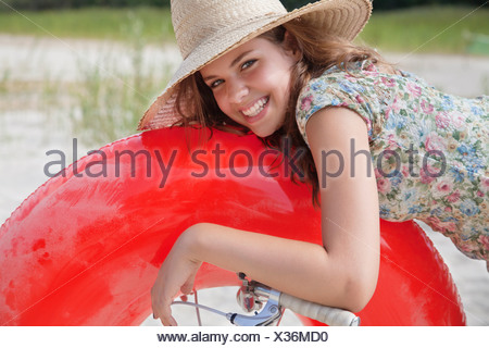 Pretty woman resting on buoyancy ring - Stock Photo