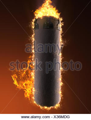 punching bag in fire - Stock Photo