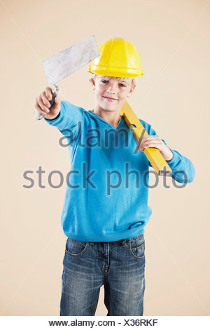 Boy dressed as a craftsman or workman - Stock Photo
