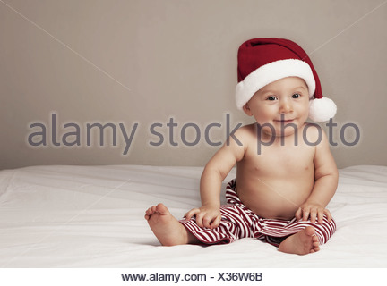 Surprised baby boy (6-11 months) - Stock Photo