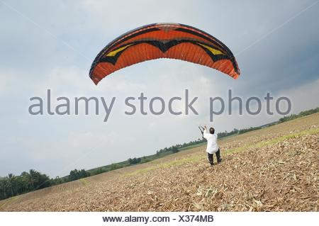 The Take Off. I wanna fly like a bird and this toll can make it happen. - Stock Photo