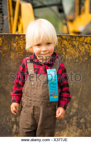 A young boy wins a prize at the Passmore Fall Fair, Castlegar, British Columbia - Stock Photo
