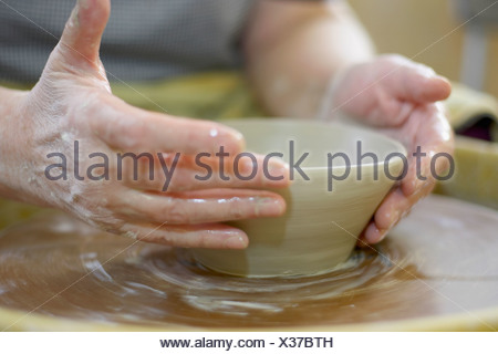 Hands molding a piece of pottery on a wheel-head, Burlington, Ontario - Stock Photo
