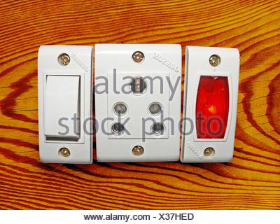 Switch board with On Off switches, 3 pin sockets - Stock Photo