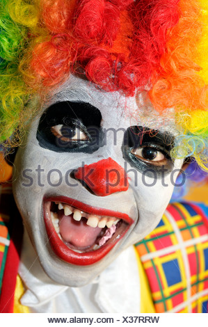Laughing boy, dressed up as a clown, Port-au-Prince, Haiti, Caribbean, Central America - Stock Photo