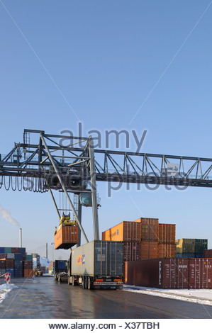 Container handling at Bonn Harbour, container being loaded onto a lorry, Bonn, North Rhine-Westphalia, Germany, Europe - Stock Photo
