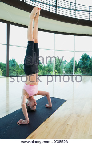 Woman Doing Headstand Stock Alamy