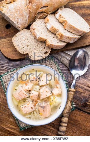 Delicious salmon soup with noodles in a bowl - Stock Photo