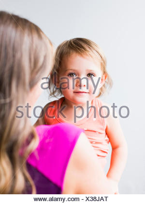 Little girl (2-3) with mother - Stock Photo