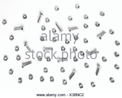 Directly Above View Of Nuts And Bolts Against White Background - Stock Photo