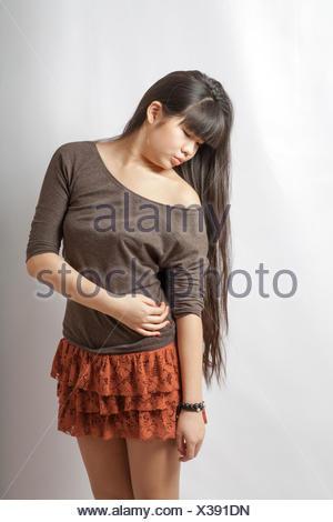 young asian model. Studio shot. - Stock Photo