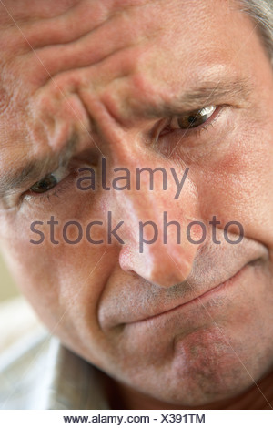 Portrait Of Senior Man Frowning - Stock Photo