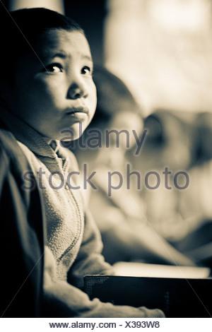 Lamayuru Monastery, Ladakh, Jammu and Kashmir, India; Young Buddhist scholars at their studies - Stock Photo