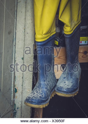 Dirty used rubber wellingtons - Stock Photo