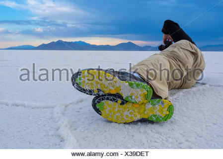 Utah, Wendover, Bonneville Salt Flats, photographer on flats - Stock Photo