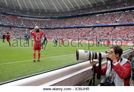 Photographer at an FC Bayern Muenchen soccer match in the Allianz-Arena, 27.08.2005, Munich, Bavaria, Germany