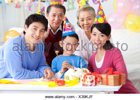 Young Chinese boy's birthday with family - Stock Photo