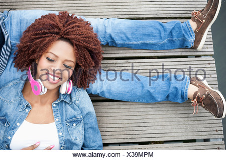 Young couple on jetty, overhead view - Stock Photo