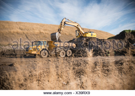 Excavator working at surface coal mine - Stock Photo