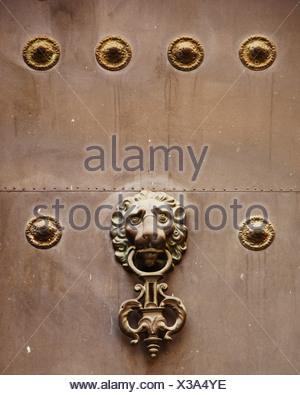 Lion head door knocker on an old door in Seville, Andalusia, Spain