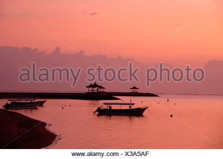 Pink-colored sunrise, boats in silhouette, beach of Sanur, Bali, Indonesia, Southeast Asia, Asia - Stock Photo