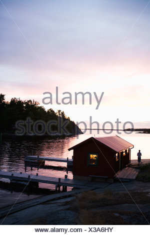 A boathouse in the sunset in the archipelago of Stockholm Sweden. - Stock Photo