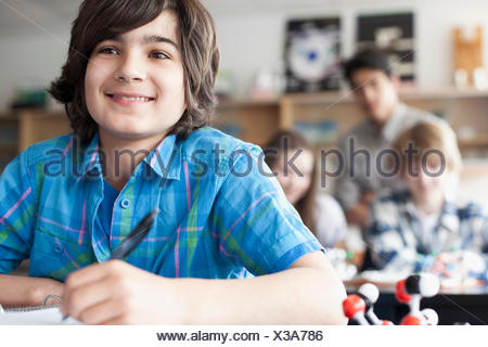 middle school students in chemistry class - Stock Photo