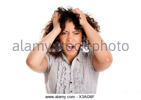 Frustrated angry formal corporate business woman with curly hair with hands in hair and screaming yelling, isolated. - Stock Photo