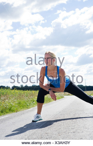 A woman doing stretching exercises Sweden. - Stock Photo