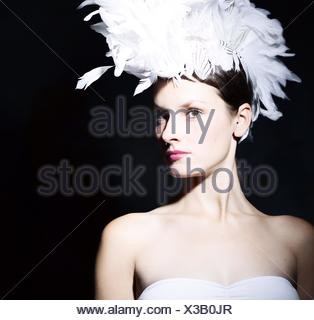 Portrait Of A Beautiful Young Woman Over Black Background - Stock Photo