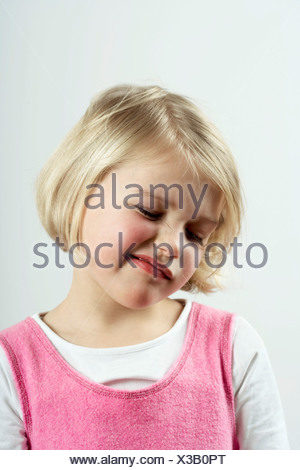 A young girl with a skeptical look