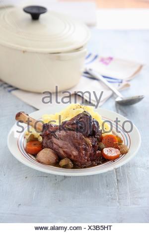 Lamb shank stew and mash potatoes, portion - Stock Photo